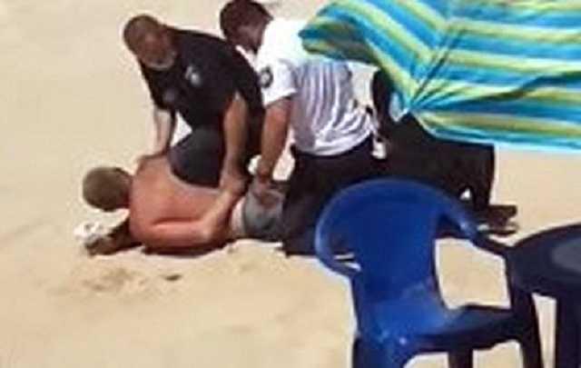 На пляже в Кирилловке полиция задержала мужчину с боевой гранатой (видео)